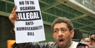 Photo of person protesting Anti-Homosexuality Act