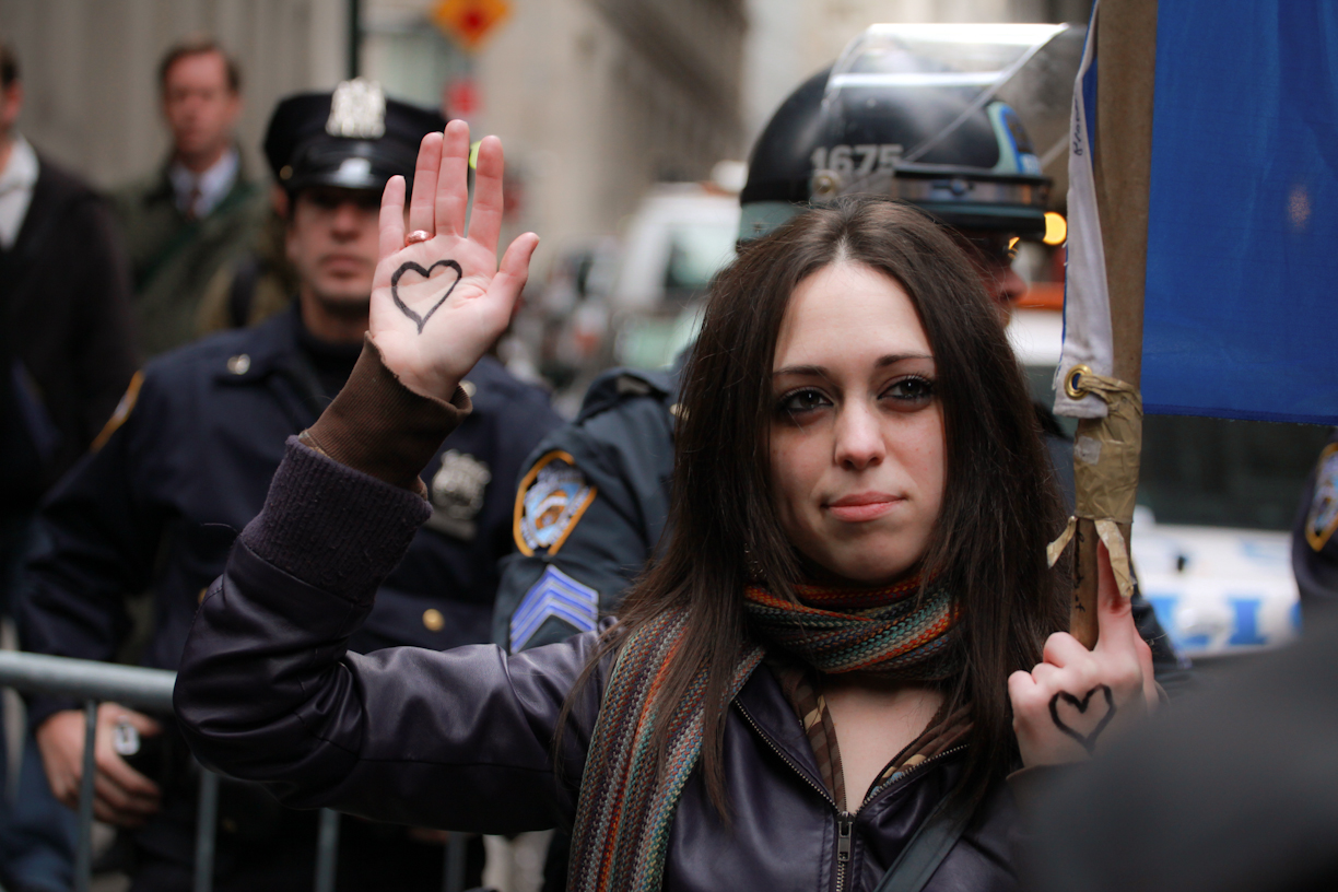 protester with heart on hand
