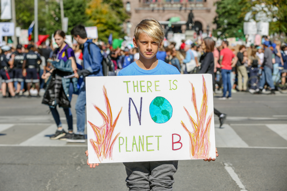 Youth holds signs at 'Fridays for Future' climate change